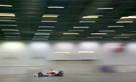 The Stig drives Toyota F1 car indoors