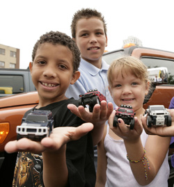 Kids with their Happy Meal HUMMER trucks