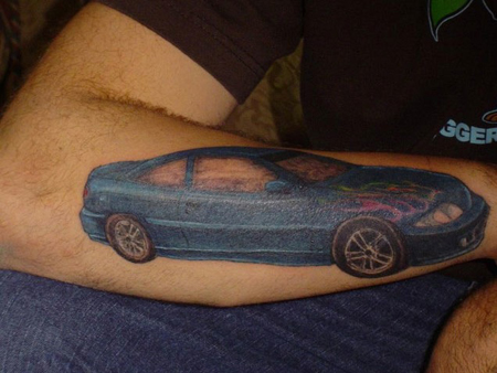 Dude tattoos a Cavalier on his arm. This was posted over from autoblog.com,