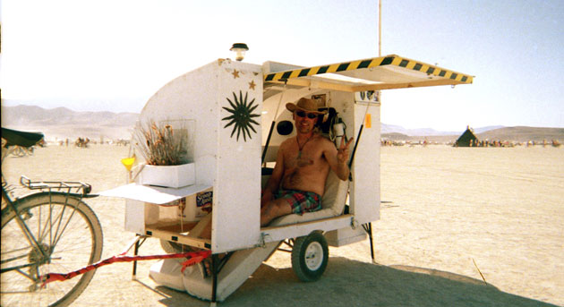 Paul Elkins in his homemade bike-pulled camper
