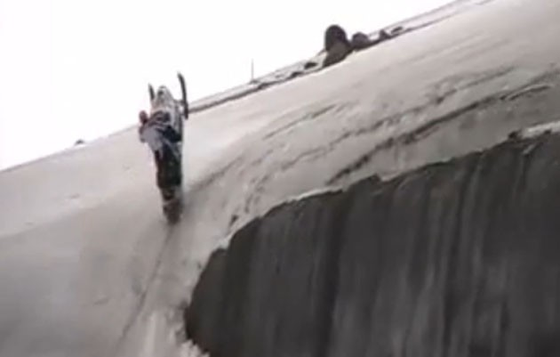 Extreme snowmobiling. Click above to watch the video after the jump