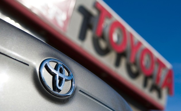 Toyota car emblem with dealer sign
