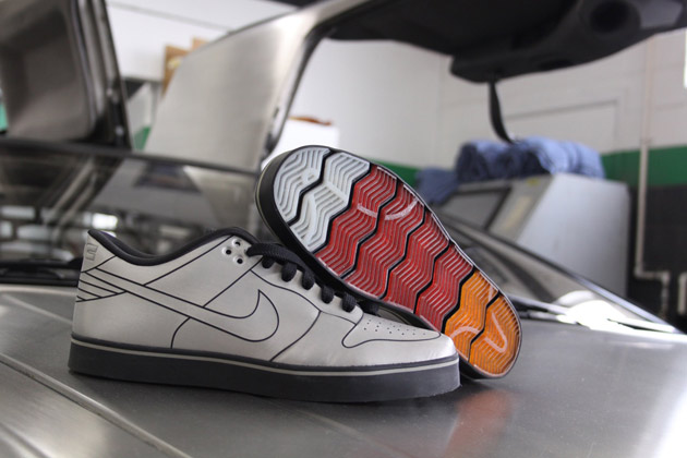Nike DeLoean shoes sitting on a DeLorean