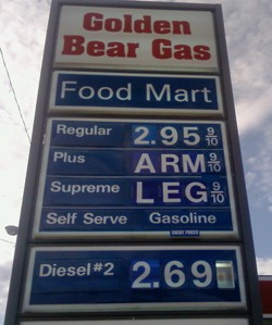 Gas price sign shows pricing at an arm and a leg