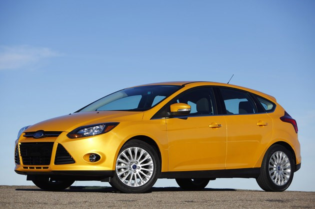 2012 Ford Focus hatchback - yellow - front three-quarter view