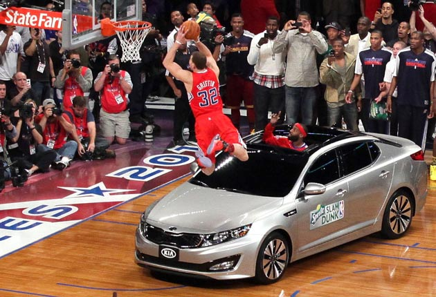 blake griffin goes airborne over a 2011 kia optima