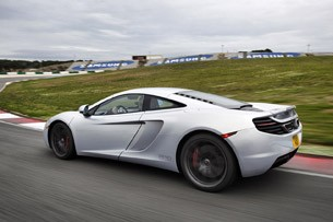 2012 McLaren MP4-12C rear 3/4 driving view