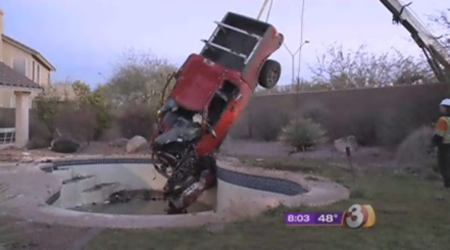 Truck upside-down in swimming pool