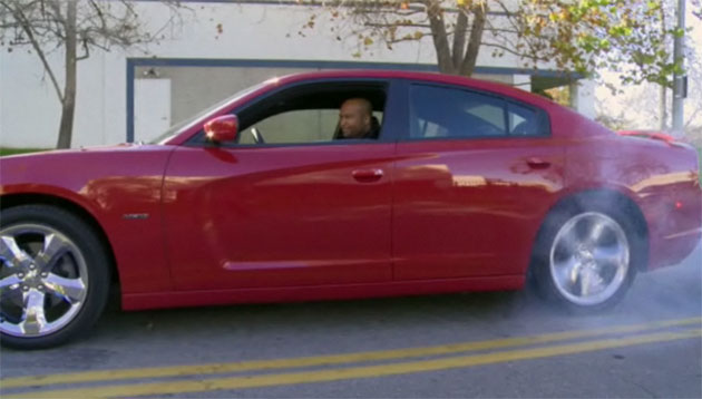 Ralph Gilles does a burnout in a 2011 Dodge Charger R/T