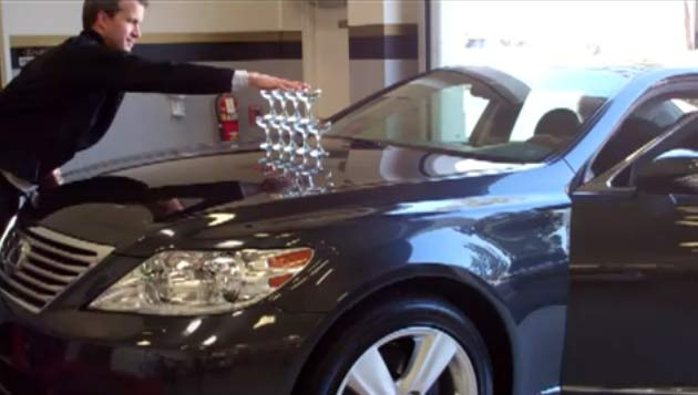 Lexus LS460 with champagne glasses stacked on its hood