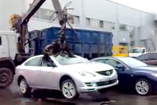 Mazda6 destroyed by giant claw