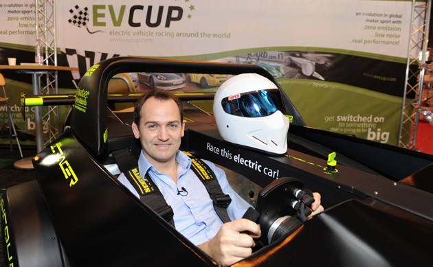 Ben Collins sits in cockpit of Westfield iRacer at EV Cup promo event