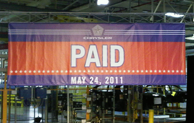 chrysler banner announces government dept paid off