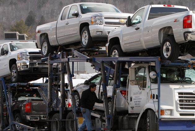 New Chevrolet pickups being delivered to dealer