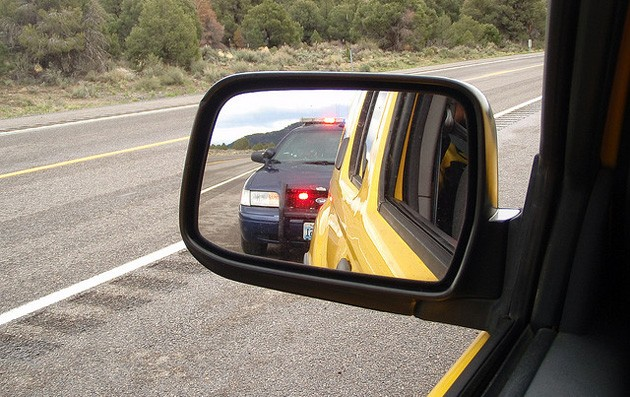 police in side view mirror