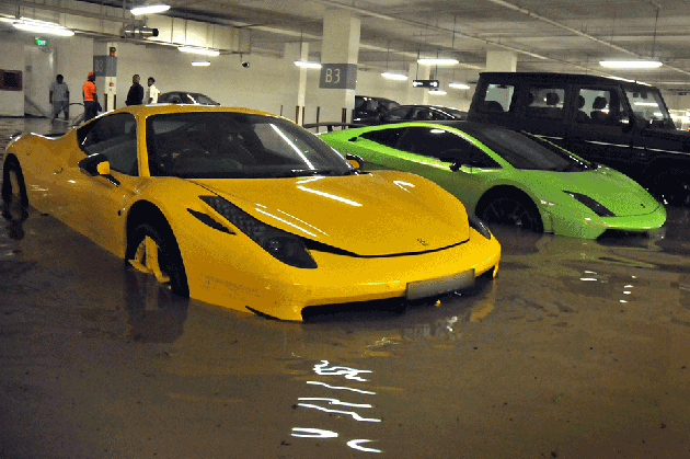 Millions in exotic cars go swimming in flooded singapore garage