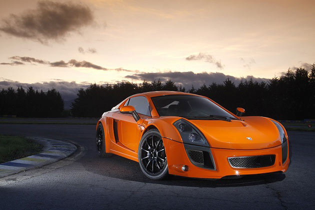 Orange 2011 Mastretta MXT on racetrack