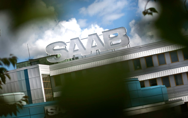Saab factory sign through the trees