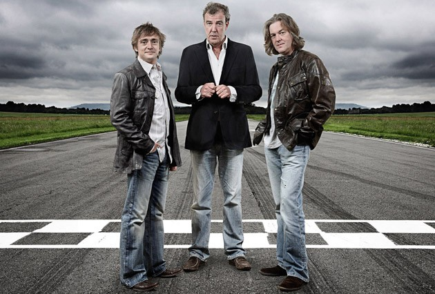 Top Gear BBC's Richard Hammond, Jeremy Clarkson and James May standing in road