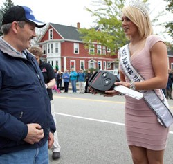 Joe LoCicero gets a key from Miss Maine