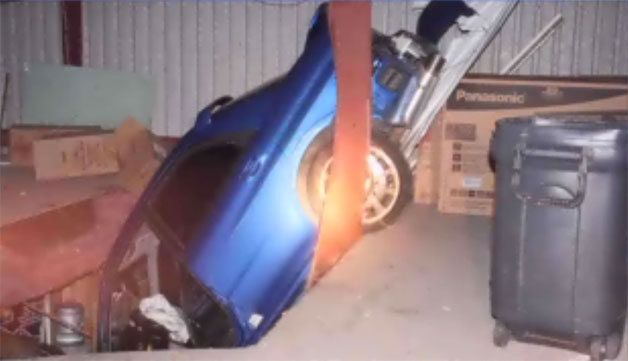 Car crashes through roof