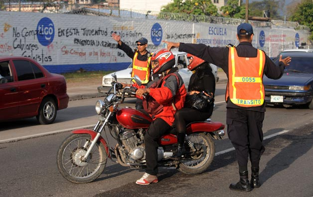 Traffic checkpoint in Honduras with motorcyclists
