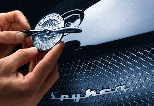 Spyker emblem being placed on car