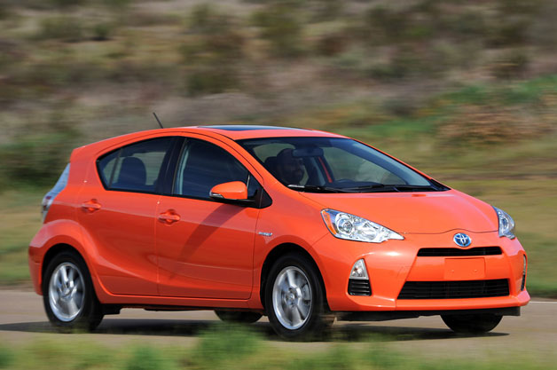 2012 Toyota Prius C - orange - front three-quarter dynamic view