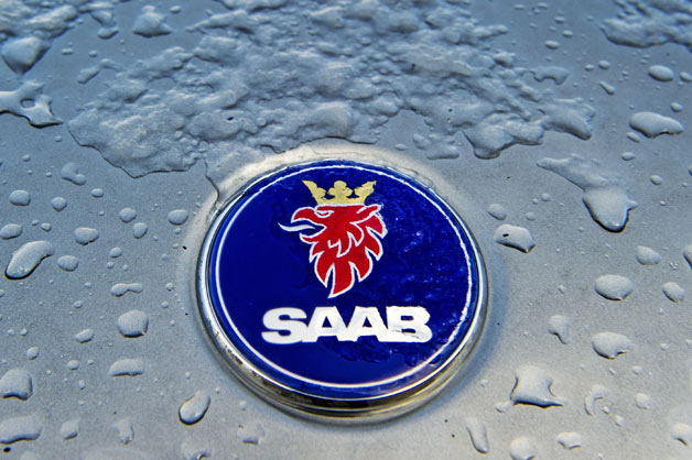 Saab emblem on hood with ice