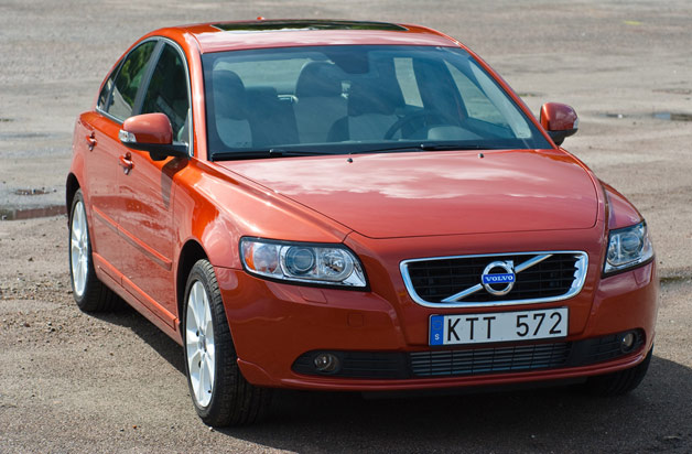 2011 Volvo V40 - front, three-quarter view (red)