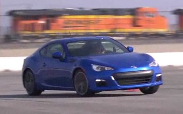 2013 Subaru BRZ in blue taking a corner at speed - video screencap