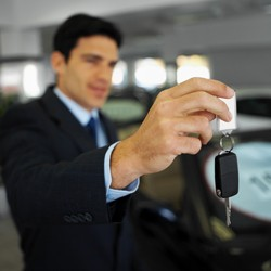 Car salesman handing over keys