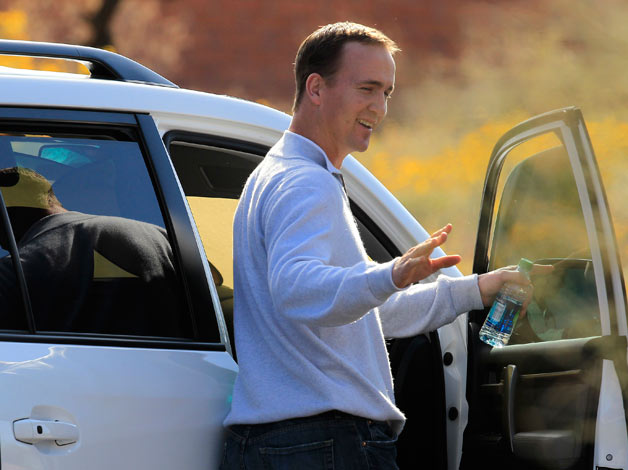 NFL quarterback Peyton Manning getting into a vehicle