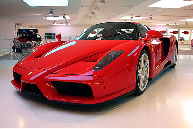 Red Ferrari Enzo displayed indoors