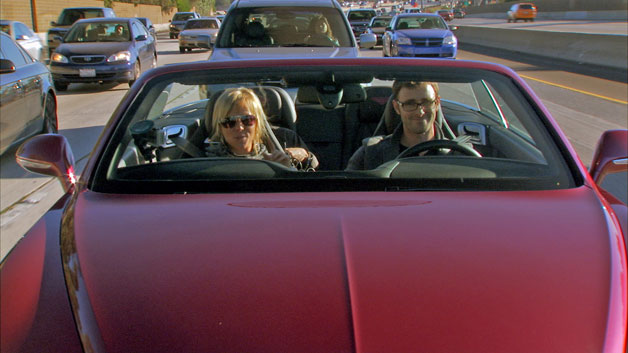 Jessi Combs and Patrick McIntyre, hosts of The List driving a Bentley on PCH