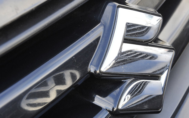 VW emblem reflected in Suzuki grille
