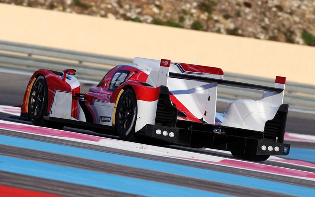 Toyota TS030 Hybrid racecar - rear three-quarter view on track