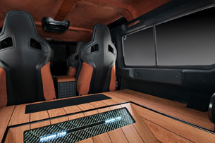 Vilner adds timber paneling to Land Rover Defender