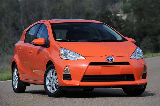 2012 Toyota Prius C - orange - tight three-quarter front static image