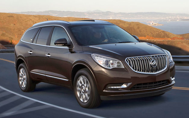2013 Buick Enclave driving shot - front three-quarter view