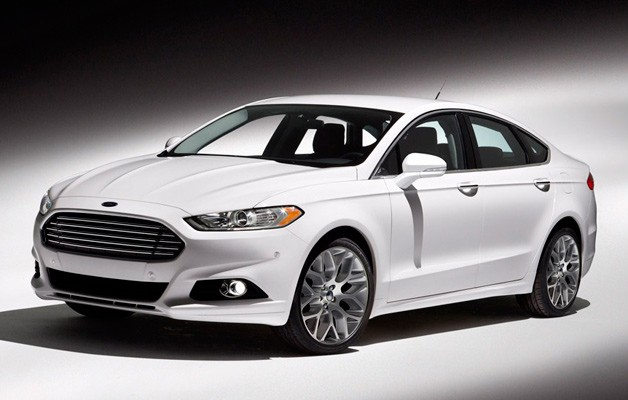 2013 Ford Fusion in white - front three-quarter view