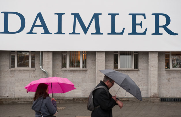Daimler sign in the rain