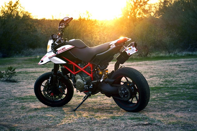 Ducati Hypermotard 1100 EVO SP - rear three-quarter view at sunset