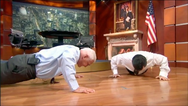 Bob Lutz takes on Stephen Colbert in a push-up contest
