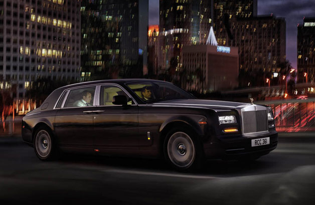 2013 Rolls-Royce Phantom Extended-Wheelbase driving through city at night