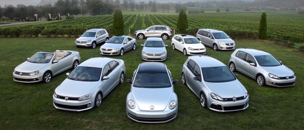 silver volkswagens parked in a field