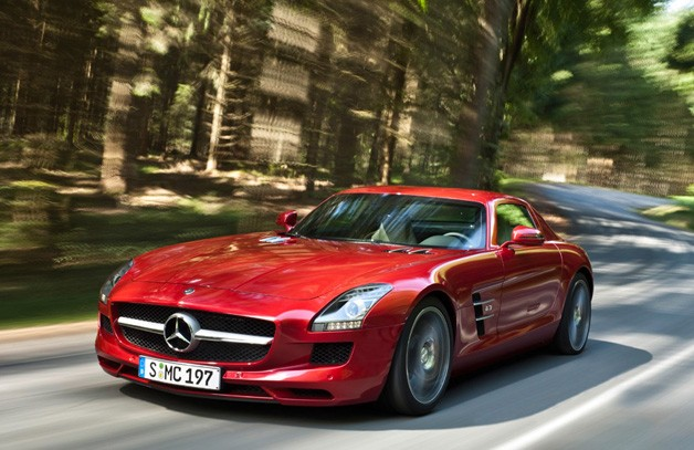 Mercedes-Benz SLS AMG - red - at speed in a forest