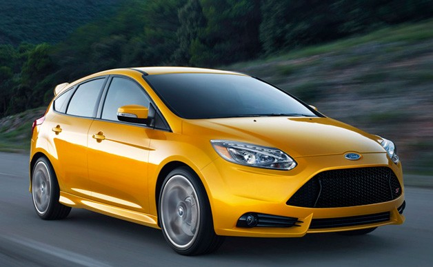2013 Ford Focus ST - gold - front three-quarter dynamic driving shot