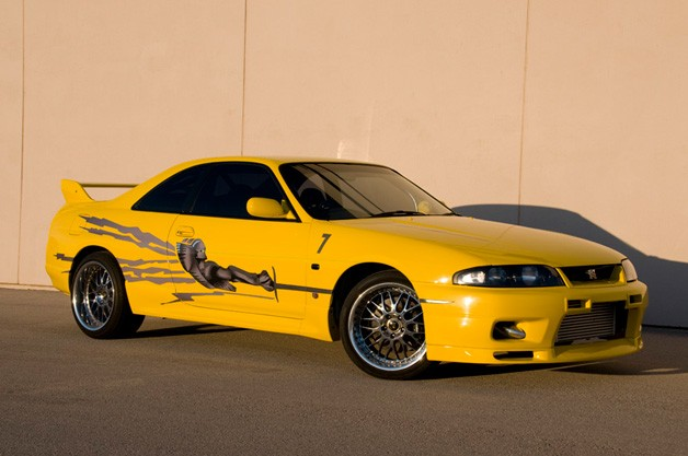 Big Bird Nissan Skyline - yellow - front three-quarter view