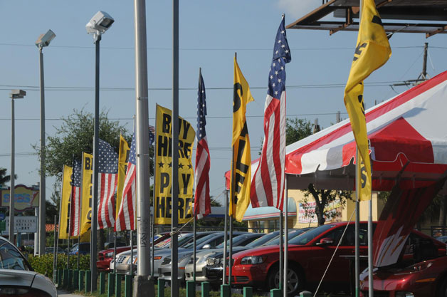 Car lot with American flags